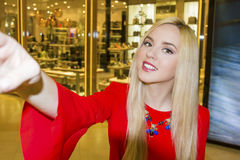 Young beautiful blond woman taking selfie with mobile phone Royalty Free Stock Images