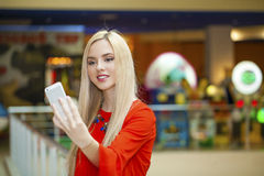 Young beautiful blond woman taking selfie with mobile phone Stock Photography