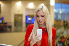 Young beautiful blond woman taking selfie with mobile phone Stock Photo