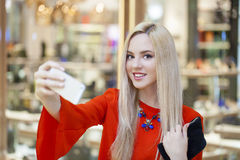 Young beautiful blond woman taking selfie with mobile phone Royalty Free Stock Photo