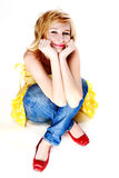 Young beautiful blonde. Is sitting on the floor cross-legged Royalty Free Stock Images