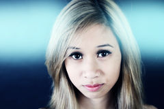 Young beautiful blonde Asian woman Royalty Free Stock Image