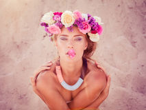 Young beautiful blonde bride in a wreath posing on the beach Stock Photography