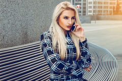Young beautiful blonde business woman with blue eyes talking pho Stock Image