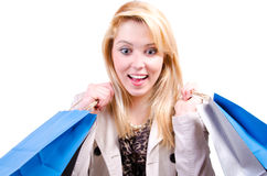 Young beautiful blonde Caucasian woman looking downwards surprised at copyspace. In white background Royalty Free Stock Photos