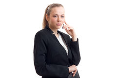 Young beautiful blonde in classic business unifrom looking at the camera Royalty Free Stock Image