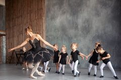 Ballerina teach girls royalty free stock photo