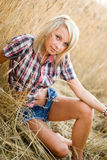 Young beautiful blonde in a field of grain Royalty Free Stock Images