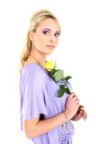 Young beautiful blonde with flower Stock Image