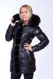 Young beautiful blonde girl in a black jacket Stock Photos