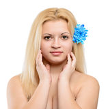 Young beautiful blonde girl with blue flower Royalty Free Stock Photography