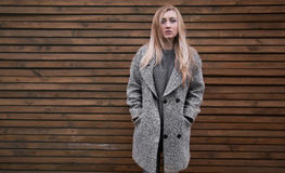 Young beautiful blonde girl in a gray coat Stock Photos