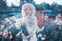 Free Young Beautiful Blonde Girl On Spring Flower Background. Woman With Pale Skin And Long Blonde Hair In White Dress. Spring Lily Stock Photography - 165722702
