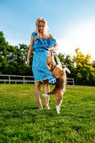 Young Beautiful Blonde Girl Walking, Playing With Beagle Dog In Park. Royalty Free Stock Photos