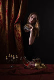 Young beautiful blonde with a gold Venetian mask Stock Image
