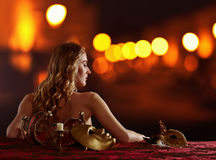 Young beautiful blonde with a gold Venetian mask Stock Photography