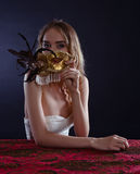 Young beautiful blonde with a gold Venetian mask Stock Images