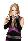 Young beautiful blonde holding a photo camera Stock Image