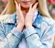 young beautiful blonde and lilac manicure royalty free stock photos