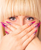 Young beautiful blonde with a nice manicure. Focus on eyes stock photos