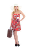Young beautiful blonde in red dress with retro suitcase isolated Stock Photo