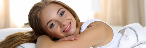 Young beautiful blonde smiling woman portrait wake up early morn Royalty Free Stock Photography