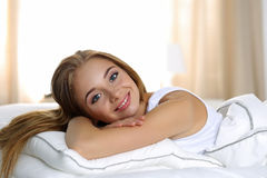 Young beautiful blonde smiling woman portrait wake up early morn Royalty Free Stock Image