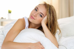 Young beautiful blonde smiling woman portrait wake up early morn Royalty Free Stock Images