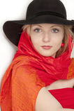 Young beautiful  blonde woman. In a  blsck hat with a red scarf looking and posing at the camera close-up Stock Image