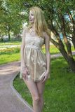 Young beautiful blonde woman in a beautiful dress in a summer park Royalty Free Stock Images