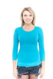 Young beautiful blonde woman with blank blue shirt Stock Photo