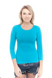 Young beautiful blonde woman with blank blue shirt Stock Image