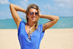Young beautiful blonde woman in blue dress posing outdoors in su. Nny weather Stock Image