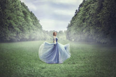 Young beautiful blonde woman in blue dress Royalty Free Stock Photos