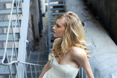 Young beautiful blonde woman in bridal dress Stock Photography