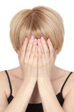 Young beautiful blonde woman covers her face Royalty Free Stock Photography