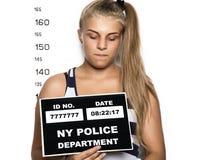 Young beautiful blonde woman Criminal Mug Shots Royalty Free Stock Photo