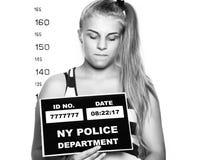 Young beautiful blonde woman Criminal Mug Shots. black and white Royalty Free Stock Image