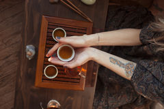 Young beautiful blonde woman. Drinking tea royalty free stock image