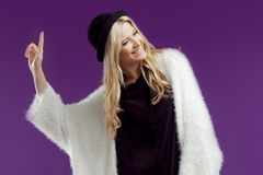 Young beautiful blonde woman in a fashionable hat. Royalty Free Stock Image