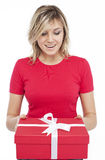 Young beautiful blonde woman gift box in hand Stock Image