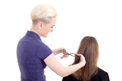 Young beautiful blonde woman hairdresser doing haircut to client Stock Images