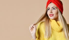 Young beautiful blonde woman happy smiling in big yellow knitted sweater blouse royalty free stock image