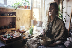 Young beautiful blonde woman. At home making tea ceremony royalty free stock image