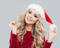 Young beautiful blonde woman in knited sweater stock image