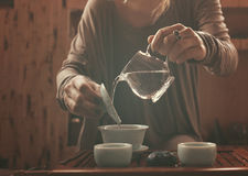 Young beautiful blonde woman. Making tea ceremony royalty free stock image