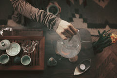 Young beautiful blonde woman. Making tea ceremony stock photos