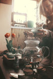 Young beautiful blonde woman. Making tea ceremony royalty free stock photos