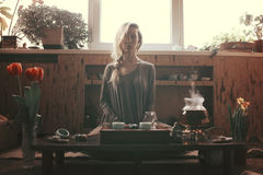 Young beautiful blonde woman. Making tea ceremony stock photo