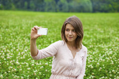 Young beautiful blonde woman photographing themselves on a cell Stock Image